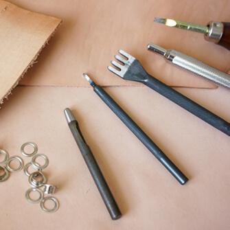 革の修理店と提携
